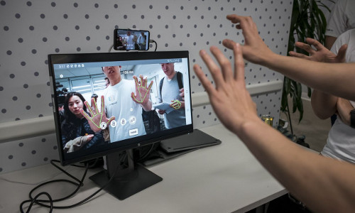 A test of hand recognition technology at an artificial intelligence conference.